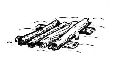 Jako podklad pro oheň na sněhu jsou nejlepší narovnaná polínka.